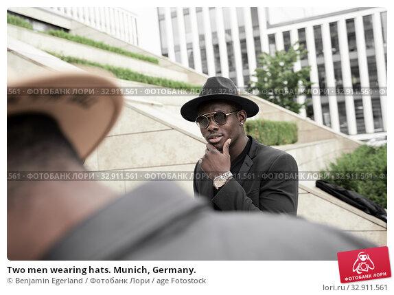 Two men wearing hats. Munich, Germany. Стоковое фото, фотограф Benjamin Egerland / age Fotostock / Фотобанк Лори