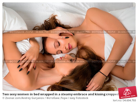 Two sexy women in bed wrapped in a steamy embrace and kissing cropped... Стоковое фото, фотограф Zoonar.com/Andrey Guryanov / easy Fotostock / Фотобанк Лори
