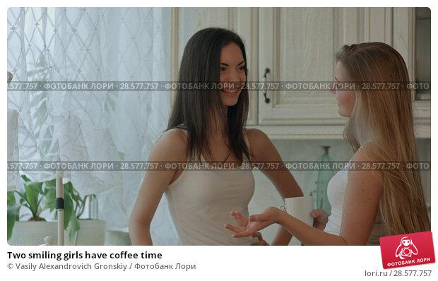 Купить «Two smiling girls have coffee time», фото № 28577757, снято 21 июня 2018 г. (c) Vasily Alexandrovich Gronskiy / Фотобанк Лори