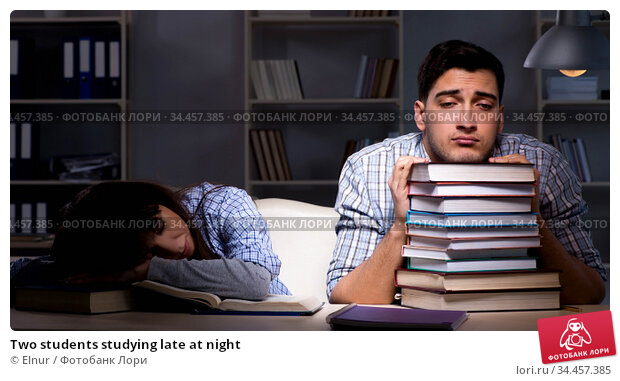 Two students studying late at night. Стоковое фото, фотограф Elnur / Фотобанк Лори