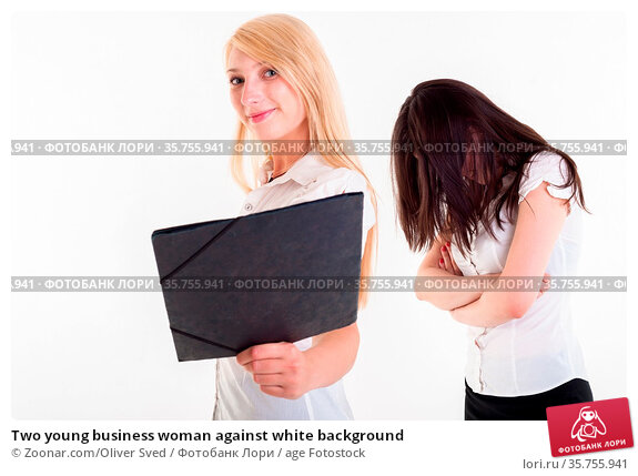 Two young business woman against white background. Стоковое фото, фотограф Zoonar.com/Oliver Sved / age Fotostock / Фотобанк Лори