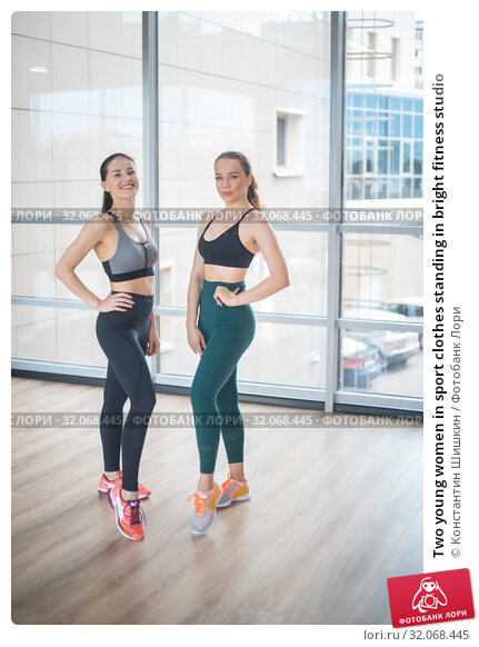 Two young women in sport clothes standing in bright fitness studio. Стоковое фото, фотограф Константин Шишкин / Фотобанк Лори