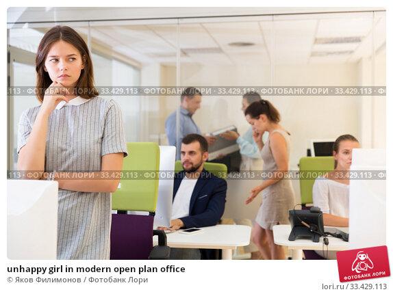 Купить «unhappy girl in modern open plan office», фото № 33429113, снято 1 августа 2018 г. (c) Яков Филимонов / Фотобанк Лори