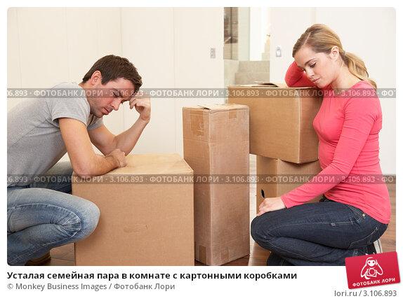 Усталая семейная пара в комнате с картонными коробками, фото № 3106893, снято 11 ноября 2010 г. (c) Monkey Business Images / Фотобанк Лори