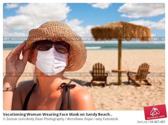 Vacationing Woman Wearing Face Mask on Sandy Beach.. Стоковое фото, фотограф Zoonar.com/Andy Dean Photography / easy Fotostock / Фотобанк Лори