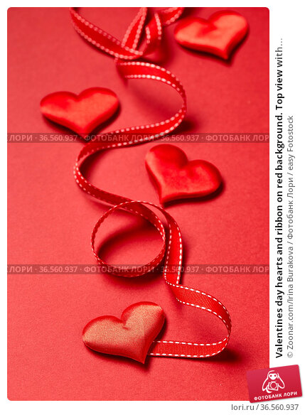 Valentines day hearts and ribbon on red background. Top view with... Стоковое фото, фотограф Zoonar.com/Irina Burakova / easy Fotostock / Фотобанк Лори