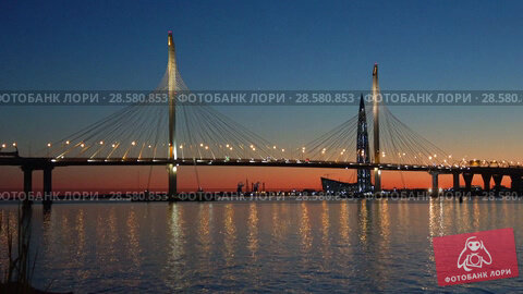 Купить «Вантовый мост на Западном скоростном диаметре майским вечером. Санкт-Петербург», видеоролик № 28580853, снято 28 мая 2018 г. (c) Виктор Карасев / Фотобанк Лори