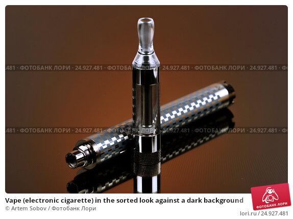 Купить «Vape (electronic cigarette) in the sorted look against a dark background», фото № 24927481, снято 19 ноября 2016 г. (c) Artem Sobov / Фотобанк Лори