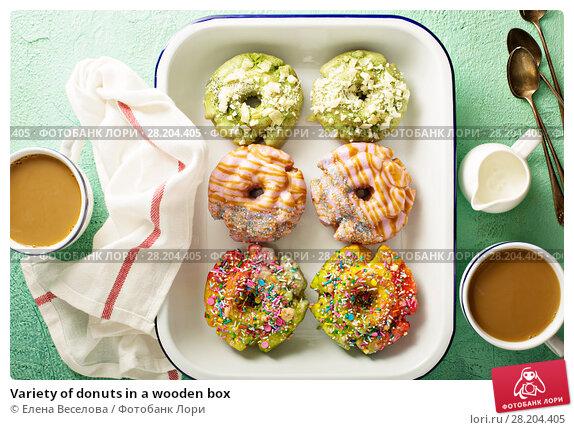 Купить «Variety of donuts in a wooden box», фото № 28204405, снято 12 марта 2018 г. (c) Елена Веселова / Фотобанк Лори