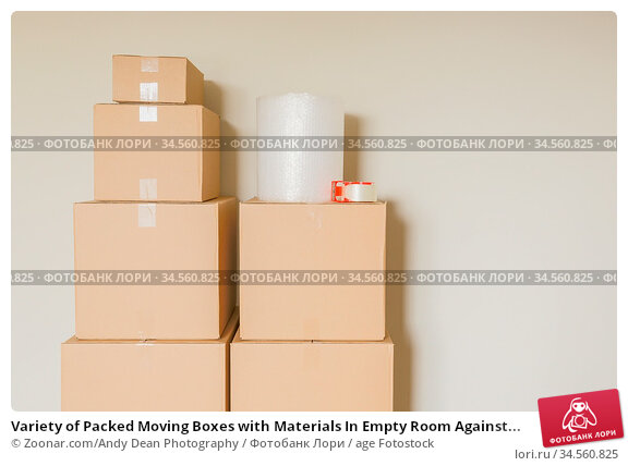 Variety of Packed Moving Boxes with Materials In Empty Room Against... Стоковое фото, фотограф Zoonar.com/Andy Dean Photography / age Fotostock / Фотобанк Лори