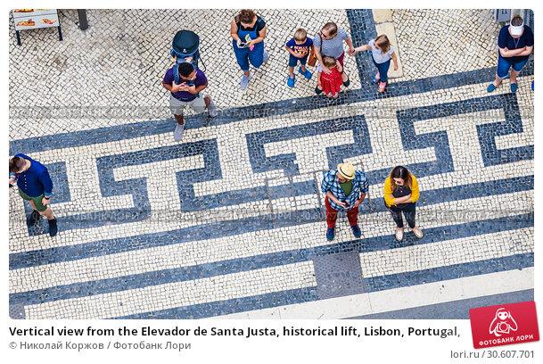Купить «Vertical view from the Elevador de Santa Justa, historical lift, Lisbon, Portugal,», фото № 30607701, снято 15 июля 2018 г. (c) Николай Коржов / Фотобанк Лори