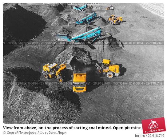 Купить «View from above, on the process of sorting coal mined. Open pit mine, Mining coal extractive industry anthracite.», фото № 29918749, снято 26 сентября 2018 г. (c) Сергей Тимофеев / Фотобанк Лори