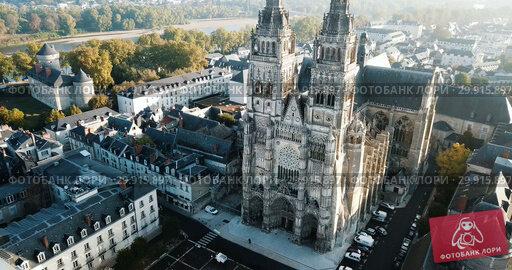 Купить «View from drone of impressive Roman Catholic Cathedral of Tours in morning, France», видеоролик № 29915897, снято 25 октября 2018 г. (c) Яков Филимонов / Фотобанк Лори