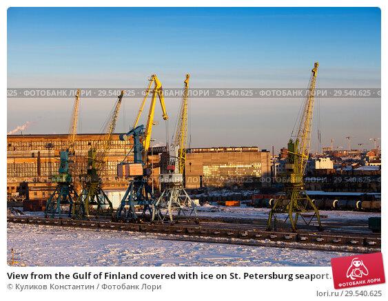 Купить «View from the Gulf of Finland covered with ice on St. Petersburg seaport. Russia», фото № 29540625, снято 16 марта 2013 г. (c) Куликов Константин / Фотобанк Лори