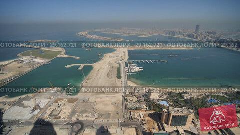 Купить «View from the heights on Palm Jumeirah in Dubai. Panorama of the coast of Dubai.», видеоролик № 29162721, снято 18 сентября 2018 г. (c) Mikhail Davidovich / Фотобанк Лори