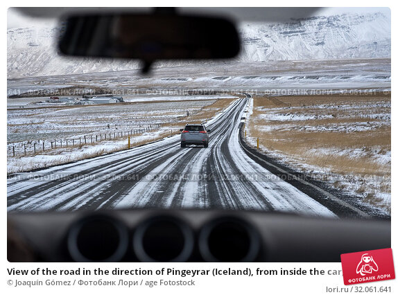 View of the road in the direction of Pingeyrar (Iceland), from inside the car, the roads of the northern part of the country have hardly any traffic at this time of the year. Стоковое фото, фотограф Joaquín Gómez / age Fotostock / Фотобанк Лори