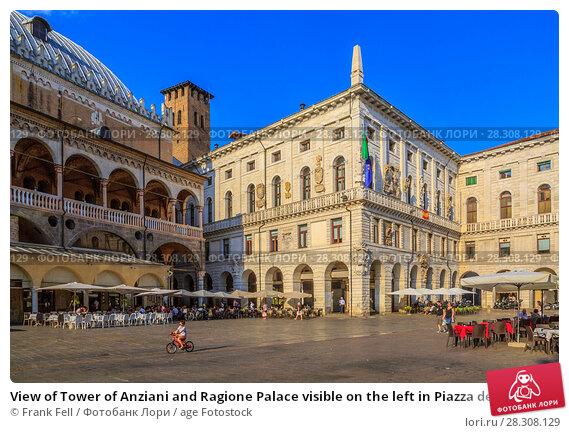 Купить «View of Tower of Anziani and Ragione Palace visible on the left in Piazza delle Erbe, Padua, Veneto, Italy, Europe», фото № 28308129, снято 23 августа 2017 г. (c) age Fotostock / Фотобанк Лори