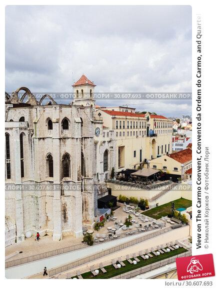 Купить «View on The Carmo Convent, Convento da Ordem do Carmo, and Quartel do Carmo, GNR National Guard headquarters from the terrace of the Santa Justa Lift.  Lisbon, Portugal», фото № 30607693, снято 15 июля 2018 г. (c) Николай Коржов / Фотобанк Лори