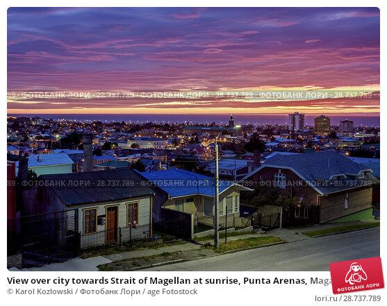 Купить «View over city towards Strait of Magellan at sunrise, Punta Arenas, Magallanes Province, Patagonia, Chile.», фото № 28737789, снято 26 марта 2018 г. (c) age Fotostock / Фотобанк Лори