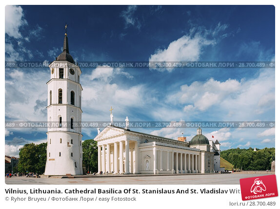 Купить «Vilnius, Lithuania. Cathedral Basilica Of St. Stanislaus And St. Vladislav With The Bell Tower In Summer Sunny Day, Blue Cloudy Sky Background. Roman Catholic Cathedral At The Cathedral Square.», фото № 28700489, снято 4 июля 2016 г. (c) easy Fotostock / Фотобанк Лори