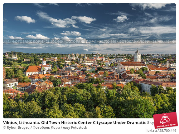 Купить «Vilnius, Lithuania. Old Town Historic Center Cityscape Under Dramatic Sky And Bright Sun In Sunny Summer Day. Travel Panorama. UNESCO World Heritage. Famous And Popular Place.», фото № 28700449, снято 5 июля 2016 г. (c) easy Fotostock / Фотобанк Лори