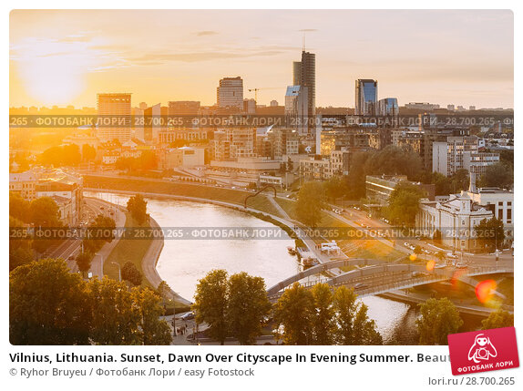 Купить «Vilnius, Lithuania. Sunset, Dawn Over Cityscape In Evening Summer. Beautiful View Of Modern Office Buildings Skyscrapers In Business District New City Centre Shnipishkes.», фото № 28700265, снято 5 июля 2016 г. (c) easy Fotostock / Фотобанк Лори