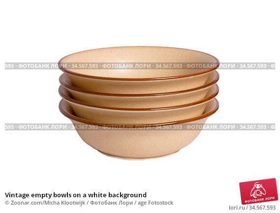 Vintage empty bowls on a white background. Стоковое фото, фотограф Zoonar.com/Micha Klootwijk / age Fotostock / Фотобанк Лори