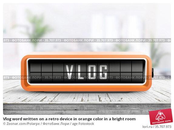 Vlog word written on a retro device in orange color in a bright room. Стоковое фото, фотограф Zoonar.com/Polarpx / age Fotostock / Фотобанк Лори