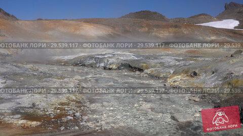 Купить «Volcano landscape of Kamchatka: hot springs surrounded by active fumaroles», видеоролик № 29539117, снято 26 сентября 2018 г. (c) А. А. Пирагис / Фотобанк Лори