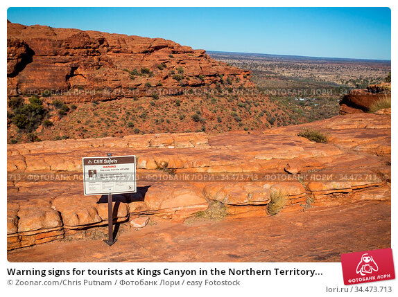 Warning signs for tourists at Kings Canyon in the Northern Territory... Стоковое фото, фотограф Zoonar.com/Chris Putnam / easy Fotostock / Фотобанк Лори