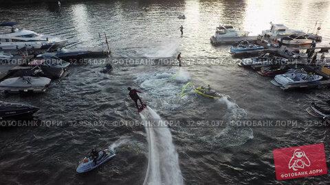 Water jet flyboard riders performing for people, aerial (2019 год). Редакционное видео, видеограф Данил Руденко / Фотобанк Лори