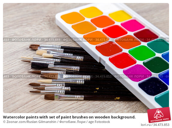 Watercolor paints with set of paint brushes on wooden background. Стоковое фото, фотограф Zoonar.com/Ruslan Gilmanshin / age Fotostock / Фотобанк Лори