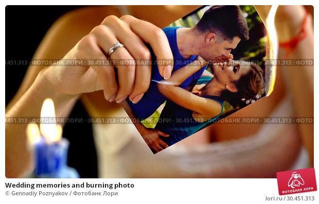 Wedding memories and burning photo. Стоковое фото, фотограф Gennadiy Poznyakov / Фотобанк Лори