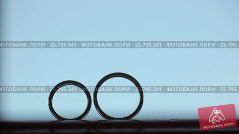 Wedding rings - one rolls to another, видеоролик № 25795341, снято 16 марта 2016 г. (c) Алексей Макаров / Фотобанк Лори