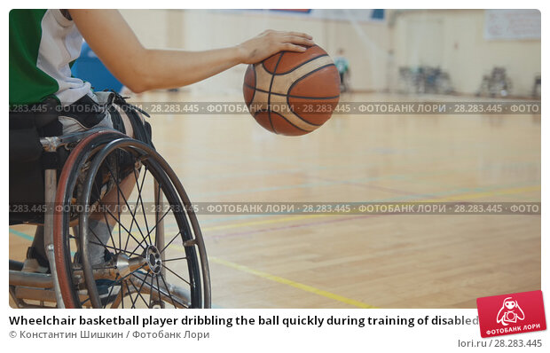 Купить «Wheelchair basketball player dribbling the ball quickly during training of disabled sportsmen», фото № 28283445, снято 21 апреля 2018 г. (c) Константин Шишкин / Фотобанк Лори