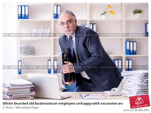 White bearded old businessman employee unhappy with excessive wo. Стоковое фото, фотограф Elnur / Фотобанк Лори