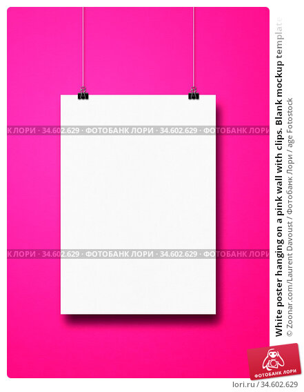 White poster hanging on a pink wall with clips. Blank mockup template. Стоковое фото, фотограф Zoonar.com/Laurent Davoust / age Fotostock / Фотобанк Лори