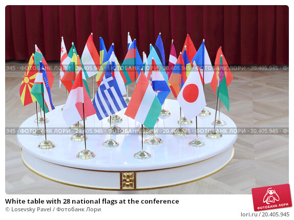 Купить «White table with 28 national flags at the conference», фото № 20405945, снято 10 октября 2013 г. (c) Losevsky Pavel / Фотобанк Лори