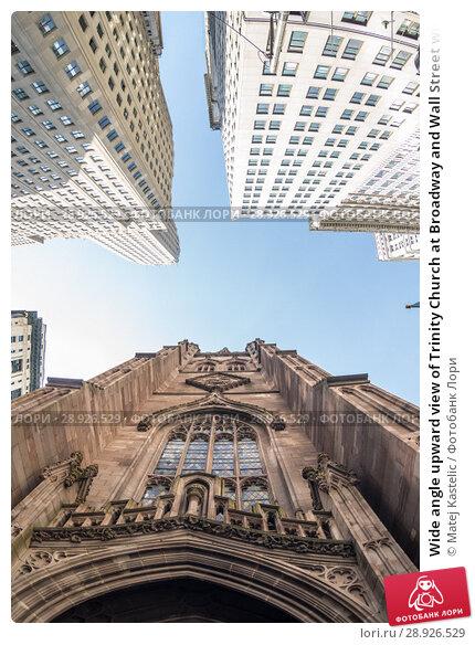 Купить «Wide angle upward view of Trinity Church at Broadway and Wall Street with surrounding skyscrapers, Lower Manhattan, New York City, USA», фото № 28926529, снято 21 августа 2018 г. (c) Matej Kastelic / Фотобанк Лори