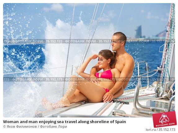 Woman and man enjoying sea travel along shoreline of Spain. Стоковое фото, фотограф Яков Филимонов / Фотобанк Лори
