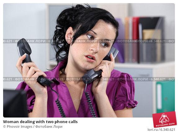 Купить «Woman dealing with two phone calls», фото № 6340621, снято 4 мая 2011 г. (c) Phovoir Images / Фотобанк Лори
