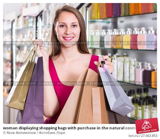 Купить «woman displaying shopping bags with purchase in the natural cosmetics shop», фото № 27063853, снято 2 мая 2017 г. (c) Яков Филимонов / Фотобанк Лори