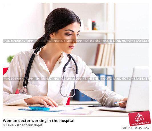 Woman doctor working in the hospital. Стоковое фото, фотограф Elnur / Фотобанк Лори