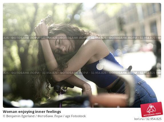 Woman enjoying inner feelings. Стоковое фото, фотограф Benjamin Egerland / age Fotostock / Фотобанк Лори