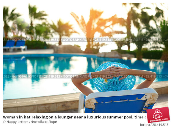 Купить «Woman in hat relaxing on a lounger near a luxurious summer pool, time concept of travel», фото № 28419513, снято 18 апреля 2018 г. (c) Happy Letters / Фотобанк Лори
