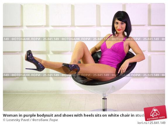 Купить «Woman in purple bodysuit and shoes with heels sits on white chair in studio», фото № 25841149, снято 4 июня 2015 г. (c) Losevsky Pavel / Фотобанк Лори