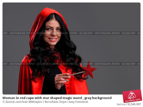 Купить «Woman in red cape with star shaped magic wand , gray background», фото № 32545997, снято 7 декабря 2019 г. (c) easy Fotostock / Фотобанк Лори