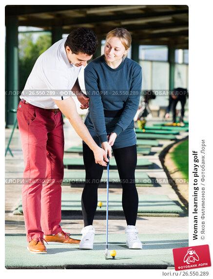 Купить «Woman learning to play golf», фото № 26550289, снято 25 апреля 2019 г. (c) Яков Филимонов / Фотобанк Лори
