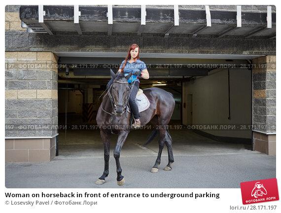 Купить «Woman on horseback in front of entrance to underground parking», фото № 28171197, снято 5 июля 2016 г. (c) Losevsky Pavel / Фотобанк Лори