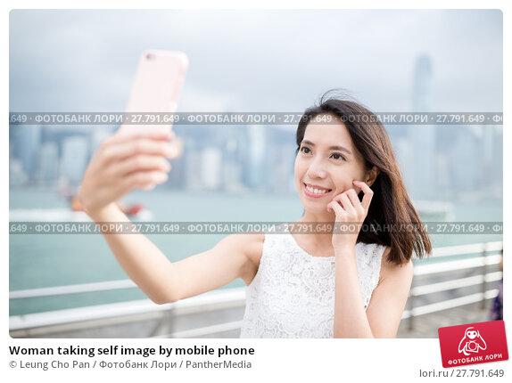 Купить «Woman taking self image by mobile phone», фото № 27791649, снято 21 февраля 2018 г. (c) PantherMedia / Фотобанк Лори